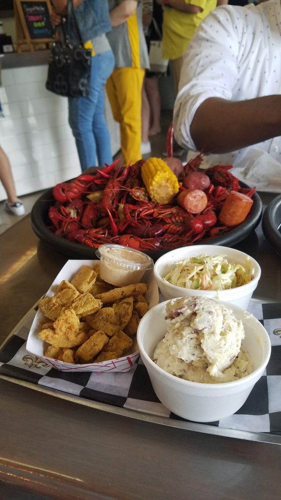 Fried green tomatoes, potato salad, cole slaw, and crawfish from Bevi Seafood
