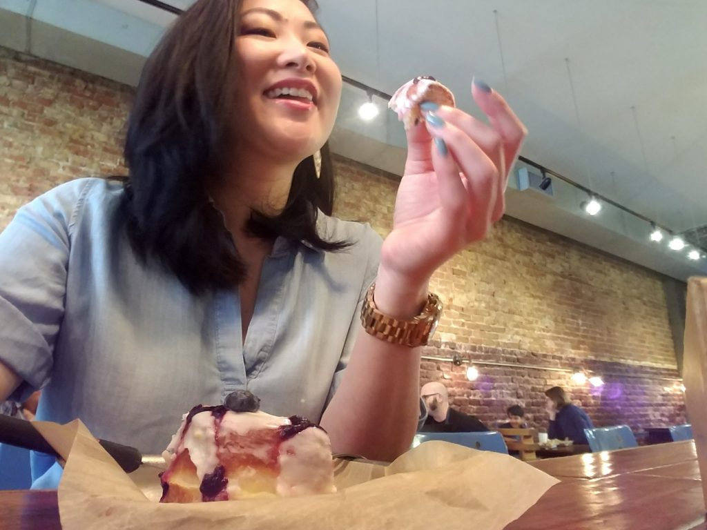 Wendy Marie with a lemon blueberry donut from District Donuts Sliders and Brew