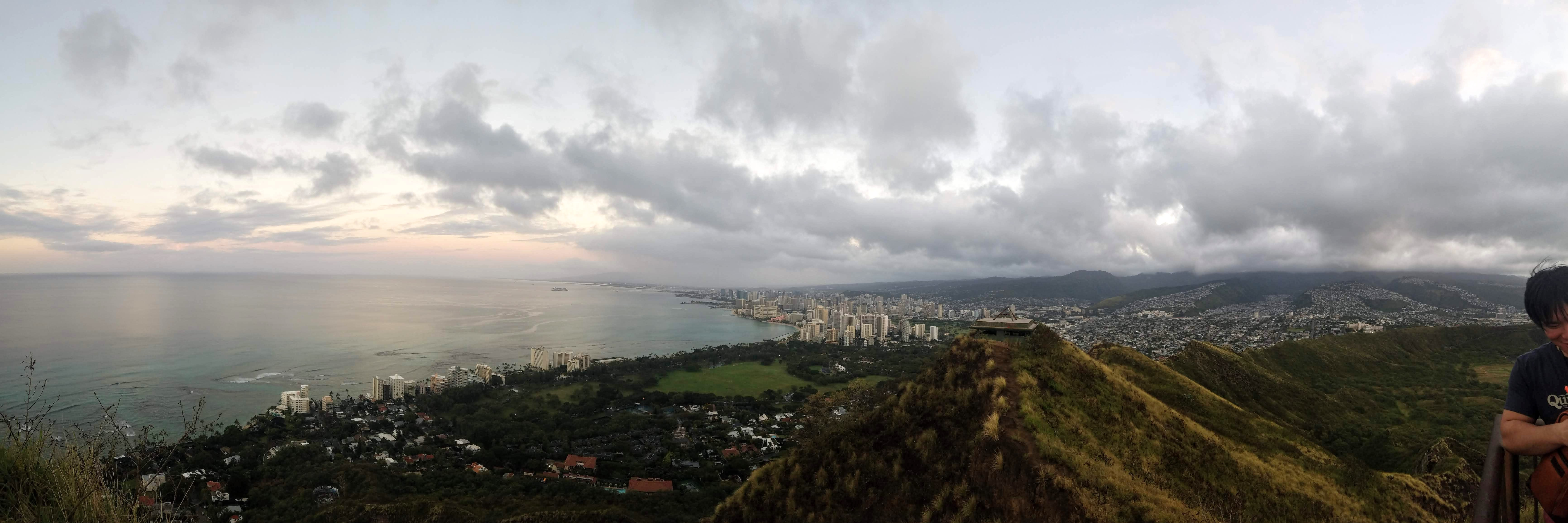 the view from the top of Diamond Head crater. this view is facing Waikiki. The ocean is to the left and the beach and Waikiki is to the right.